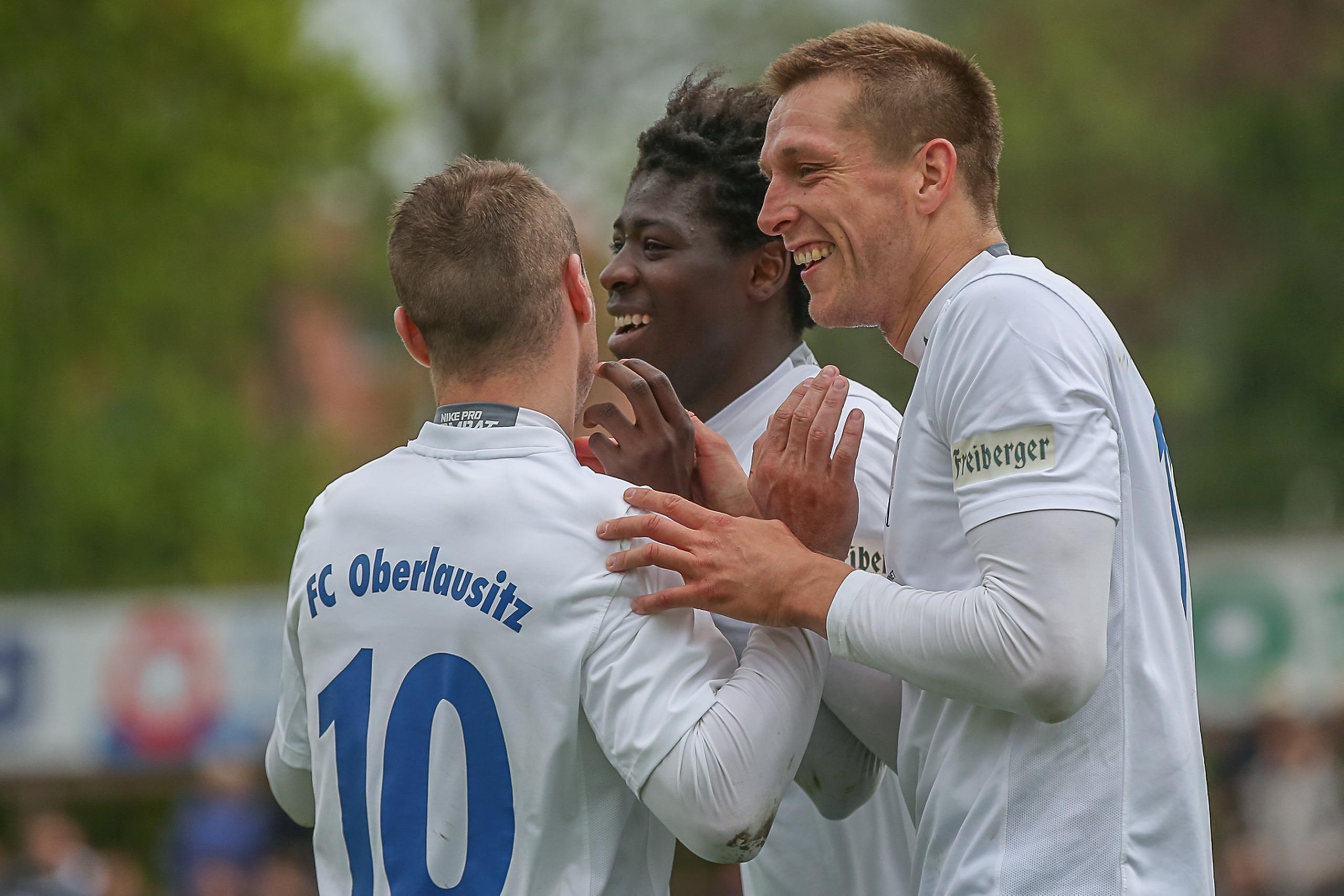 Bocar Djumo celebrates with team mates (centre). Photo by Florian Richter